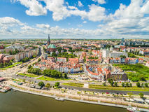 Szczecin - Wielickie embankment from the bird`s eye view. Landscape of old town with visible basilica and castle. City of Szczecin with the Oder River. Photos stock image