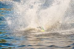 A young man performs an acrobatic jump on a surfboard on Lake Tr royalty free stock photography