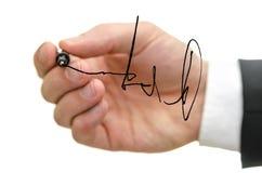 Szczegół męski ręki writing podpis na szklanej desce Zdjęcia Royalty Free