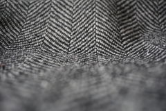 Szczegół nowożytna woolen kiesa z czarnymi & białymi liniami w formie strzała (rybiej kości wzór) Obrazy Royalty Free