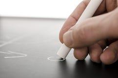 Powozowa ręka pisze mecz futbolowy strategii Zdjęcia Stock