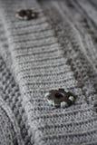 Szczegół szarość zapina przymocowywać woolen pulower Zdjęcia Royalty Free