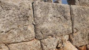 szczegółowe prawdziwe tło bardzo kamień Stara kamienna tekstury ściana w starożytnego grka mieście Lyrboton zdjęcie wideo