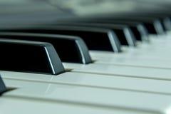 Szczegółowi fortepianowi klucze z tło plamą obrazy royalty free