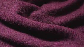 Szczegółowy strzał Burgundy koloru syntetyczny pulower w tkaniny robi zakupy zbiory wideo