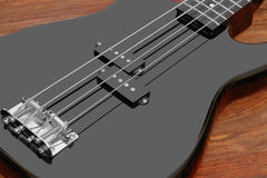 szczegół basowa czarny gitara Zdjęcie Stock