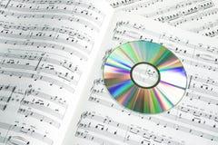 Szczegół kolorowy cd na fortepianowym wyniku Obrazy Royalty Free