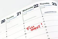 Szczepionka przeciw grypie przypomnienie na kalendarzu Obraz Stock