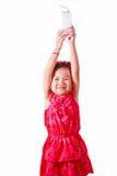 Szczęśliwa dzieciak dziewczyna pije mleko lub jogurt Fotografia Royalty Free