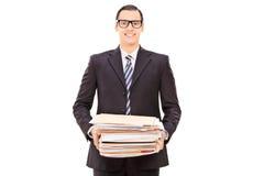 Szczęśliwy biznesmen trzyma stos papierkowa robota Obraz Stock