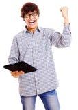 Szczęśliwy facet z pastylka komputerem osobistym Fotografia Royalty Free