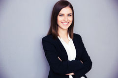 Szczęśliwy młody bizneswoman z rękami składać Obrazy Stock