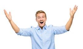 Szczęśliwy młody człowiek odświętności sukces na białym tle Zdjęcia Royalty Free