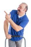 Szczęśliwy wieka średniego mężczyzna Wskazuje lewica Zdjęcia Stock