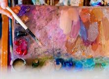 Szczotkarski artysta i paleta artysty warsztat s obrazy royalty free