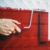 szczotkarski farby czerwieni rolownik Obraz Stock