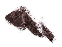 Szczotkarski strok czarny cień tusz do rzęs na bielu Zdjęcia Stock