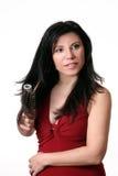 szczotkujący żeńskiego jej włosy Zdjęcia Stock
