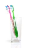 szczotkuje wśrodku zębu kolorowego szkło dwa Zdjęcie Stock