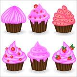 Sześć babeczek z różową śmietanką, jagodami i proszkiem, Cukierki, deser Fotografia Stock