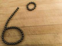 Sześć stopni symbolu w magnesowych balowych pelengach zdjęcie stock