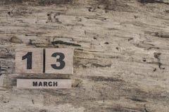 Sześcianu kalendarz dla marszu na drewnianym tle Obrazy Royalty Free