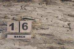Sześcianu kalendarz dla marszu na drewnianym tle Obraz Royalty Free
