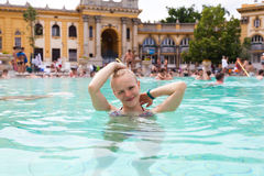Szechenyi Baths in Budapest, Hungary. Woman taking a bath outdoors Stock Photos