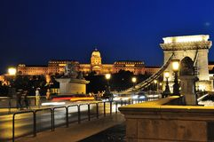 Szechenyi Chain Bridge and Buda Castle at night. Széchenyi lánchíd or Szechenyi Chain Bridge is a suspension bridge that spans the River Danube between Buda Royalty Free Stock Photos