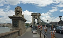 Budapest, Hungary - 15.07.2015: The Szechenyi Chain Bridge and cyclists royalty free stock photography