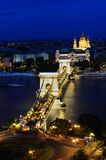 Szechenyi Chain Bridge at night. Széchenyi lánchíd or Szechenyi Chain Bridge is a suspension bridge that spans the River Danube between Buda and Pest, the Stock Photo