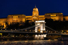 Szechenyi Chain Bridge and Royal Palace at dusk Stock Photos