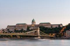Szechenyi Chain Bridge and Royal Palace at dusk Royalty Free Stock Image