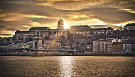 Szechenyi Chain Bridge and Royal Palace, HDR. Hungarian landmarks, Chain Bridge, Royal Palace and Danube river in Budapest at sunset, HDR image Royalty Free Stock Photography