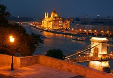 Budapest at night - The famous Chain Bridge across the Danube and the Hungarian Parliament seen from Gellert hill. Stock Photos