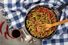 Szechuan猪肉混乱油炸物用青豆 免版税库存照片