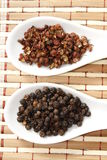 Szechuan and black pepper Stock Photography