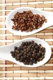 Szechuan and black pepper Royalty Free Stock Images