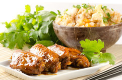 Szechuan chicken wings with fried rice Royalty Free Stock Image