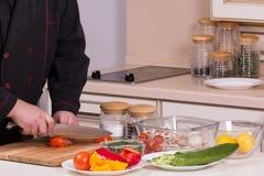 Szef kuchni ciie pomidory Zdjęcie Royalty Free