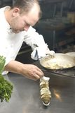 szef kuchni działanie Obraz Royalty Free
