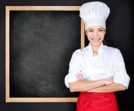 Szef kuchni pokazuje menu blackboard Obraz Stock