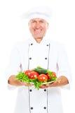 szef kuchni szczęśliwi mienia talerza warzywa Zdjęcia Royalty Free