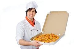Szef kuchni z pizzą fotografia royalty free