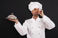 Szef kuchni z talerzem zdjęcie stock