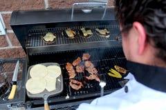 Szefa kuchni kucharstwa wołowina piec na grillu Fotografia Royalty Free