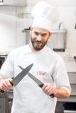 Szefa kuchni kucharz przy kuchnią zdjęcia royalty free