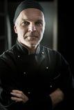 Szefa kuchni portret z rękami krzyżować Zdjęcia Royalty Free