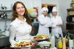 Szefowie kuchni i młody kelner Zdjęcia Royalty Free