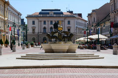 Szeged Hungary city center. Photographed in city center of Szeged, Hungary. In the middle there is a monument with iron lions. Around are caffee, shops and Royalty Free Stock Photos
